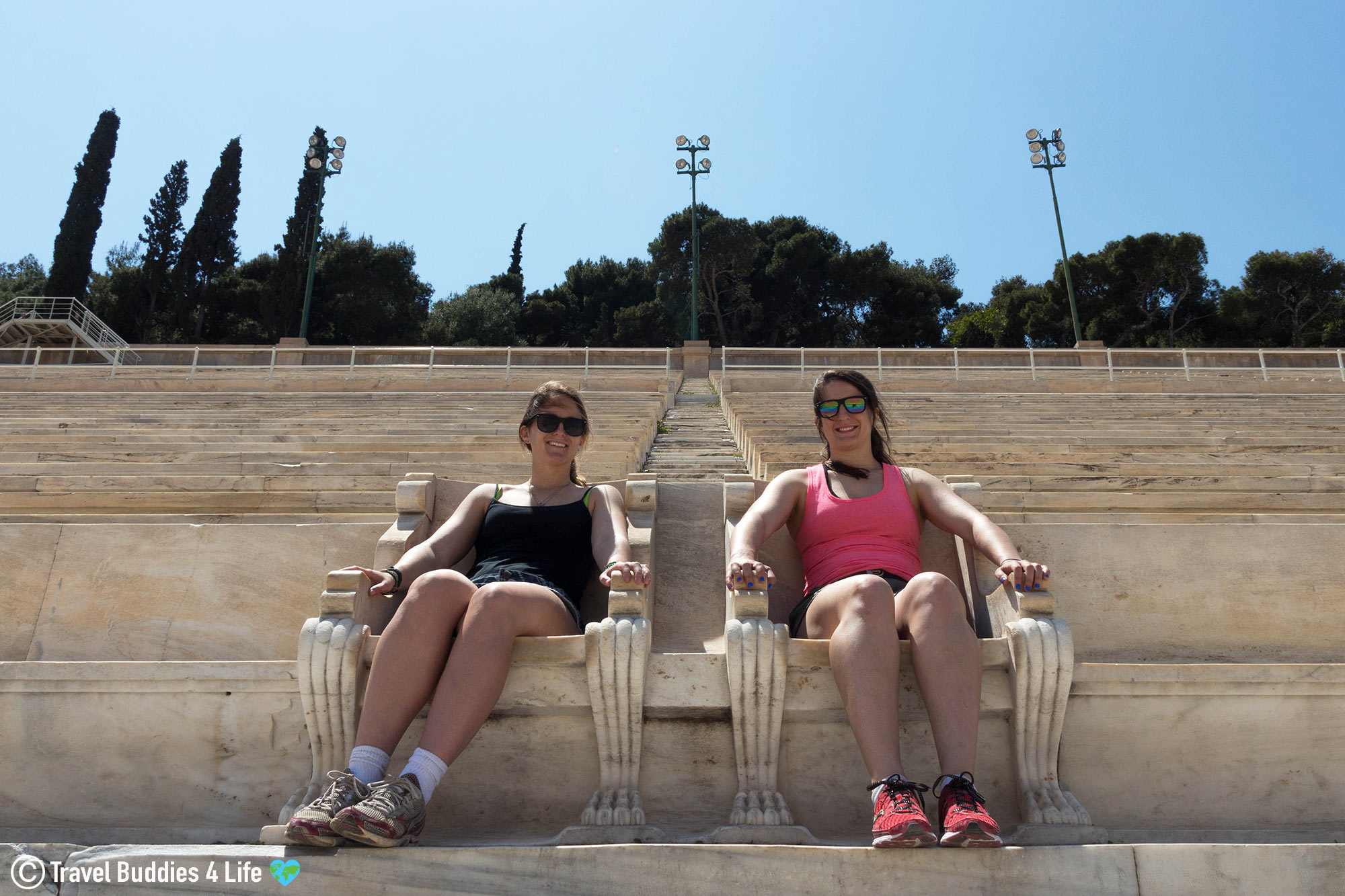 Two Female Traveler's Sitting In Important Seats At The Athens Panathenaic Stadium In Greece, European Travel