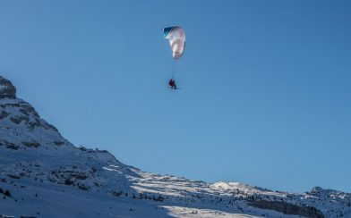 Two Skiers Paragliding In Flaine