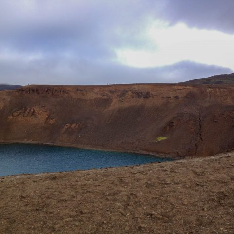 Volcanic Sand and a Peak at the Crater Lake