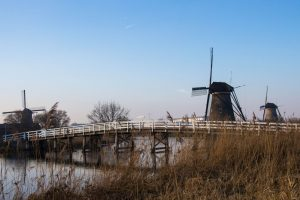 Windmills With A Bridge At The Kinderdijk In Holland