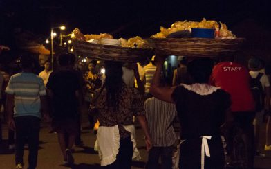 Women Carrying Baskets on Their Head